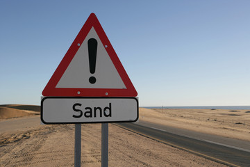 Sand warning sign in desert