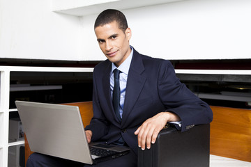 Businessman in office with laptop