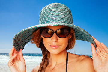 Young woman wearing sun hat on the beach