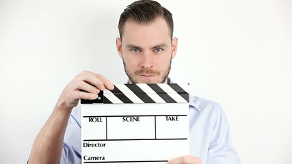 Man with movie slate