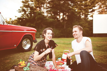 USA, Connecticut, Couple having picnic, vintage car in background