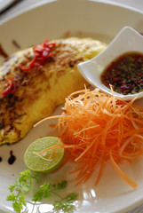 Colorful dish with lime, carrots and soy sauce