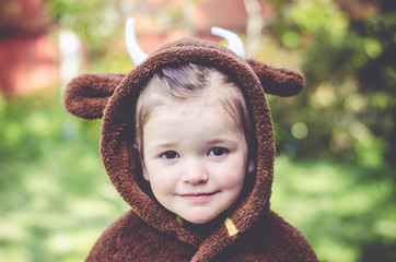 Girl wearing costume of Gruffalo