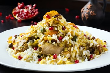 Festive middle eastern rice dish with chicken, orange peel and pistachios