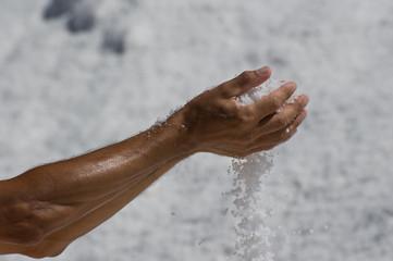 Human hand holding salt