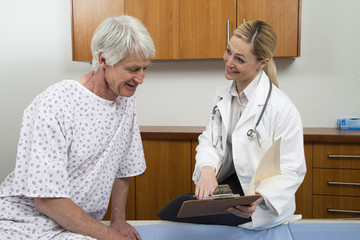 Female Doctor Talking To Male Patient
