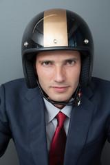 Businessman wearing crash helmet