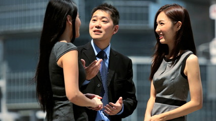 Young Ethnic Business Colleagues Meeting Downtown