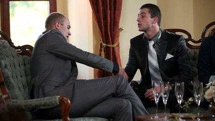 Two business man making deal while shaking hands
