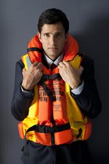 Worried businessman wearing life jacket