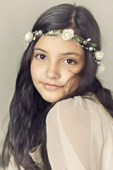 Little girl (6-7) portrait in white