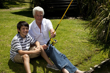 South Africa, Grandfather and grandson fishing