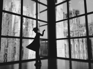 Italy, Lombardy, Milan, Woman dancing in front of duomo