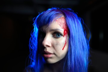 Portrait of sexy woman with blue hair looking as killer victim