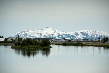 Iceland, Eyjafjordur, Akureyri, View of townscape with mountain in background