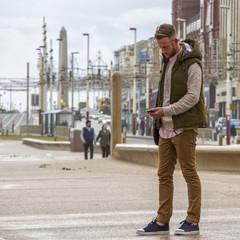 UK, England, Blackpool, Man texting