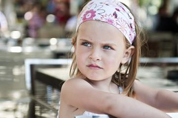 Little girl looking away