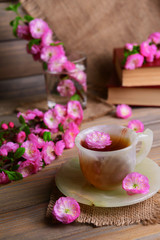 Beautiful fruit blossom with cup of tea © Africa Studio