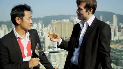 Happy Multi Ethnic Advertising Executives Celebrating Rooftop Bar