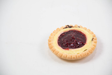 single raspberry jam filled tart