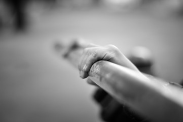 Hands of child playing in park