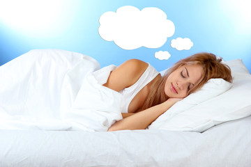 Beautiful sleeping young woman and space for text in cloud