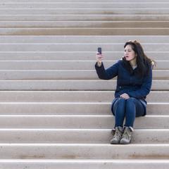 UK, Blackpool, Women taking photo on mobile phone