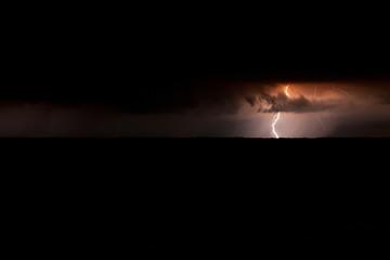 Storm over lake at night