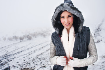 Portrait of smiling woman in snowcapped field
