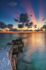 Malaysia, Sabah, Ray of Light sunset at Mabul Island