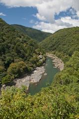 Japan, Kyoto, Arishiyama, Elevated view of river between green hills