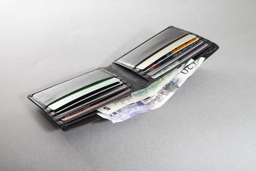 Open wallet with british banknotes