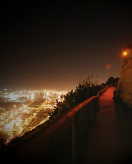 Spain, Barcelona,  Golden Path near castle at night