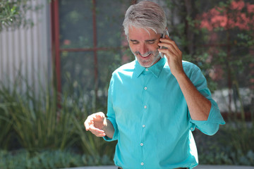Businessman outdoors talking on mobile phone