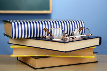 Stack of books with glasses