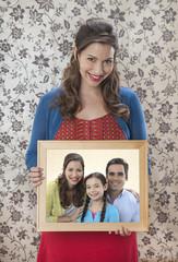 Woman holding family portrait