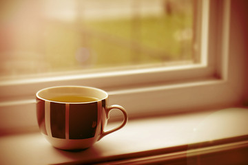 Cup on window sill