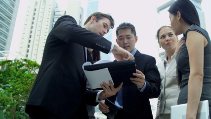 Young Multi Ethnic Business Team Tablet Hot Spot Outdoors