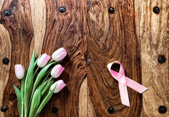 Tulips and Breast Cancer Ribbon on Rustic Table