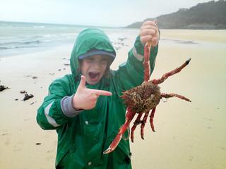 United Kingdom, Cornwall, St Ives, Boy (12-13) holding Giant Crab