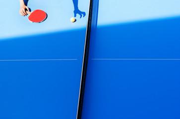 Human hand on tennis table