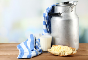 Retro can for milk with fresh bread and glass of milk