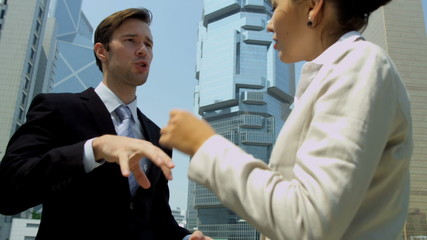 Multi Ethnic Business Consultants Meeting Outside Downtown