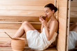 Woman in sauna - 77427943