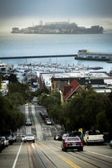 USA, California, San Francisco, View of traffic on hill and Alcatraz Island in background