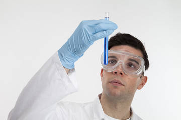 Male Scientist looking at test tube