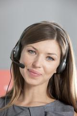 Portrait of smiling woman wearing headset