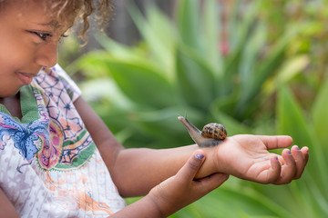 Girl with snail on arm