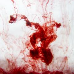 Red ink into water, studio shot
