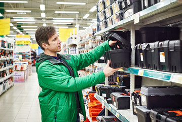 Man buying toolbox in store